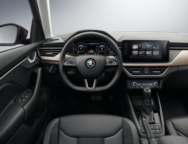 <strong>FUNKSJONELT:</strong> Interiøret er åpenbart designet for brukervennlighet, noe vi tradisjonelt forbinder med Skoda, men designen er ny og inspirert av konseptbilen Vision RS. Foto: Skoda