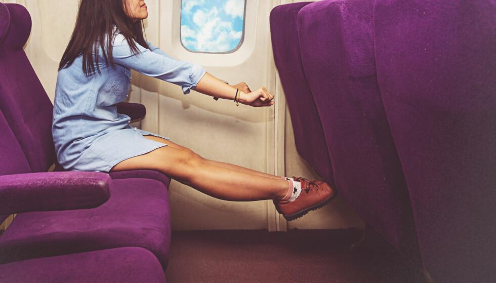 ROMSLIG: Noen flyselskaper tilbyr mye mer beinplass for passasjerene enn andre, til og med på økonomiklasse. Få tipsene i artikkelen under. Foto: Scanpix.