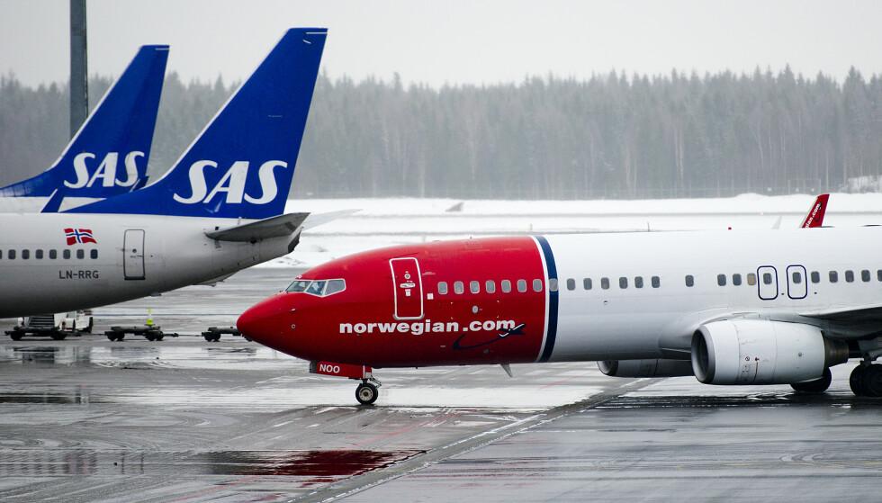 <strong>FLYSELSKAPENE VIL IKKE ETTERFAKTURERE:</strong> Den nye flypassasjeravgiften betyr at det blir mindre å betale for deg som reiser i Europa, men mye mer for deg som reiser utenfor Europa. Men hverken SAS, Norwegian eller Widerøe kommer til å etterfakturere eller å refundere penger til kunder som allerede har kjøpt billett med «gammel» flypassasjeravgift, når den nye flypassasjeravgiften trer i kraft 1. april. Foto: NTB scanpix