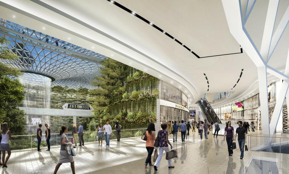 SINGAPORE CHANGI: Verdens 7. travleste flyplass. Her kan du handle i over 400 butikker og spise eller drikke på 140 serveringssteder. Det lander eller tar av 7400 fly hver uke, eller om lag ett hvert 80 sekund. Foto: Jewel Changi Airport Devt