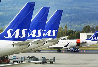 Tre av fire SAS-fly kan bli stående på bakken fredag