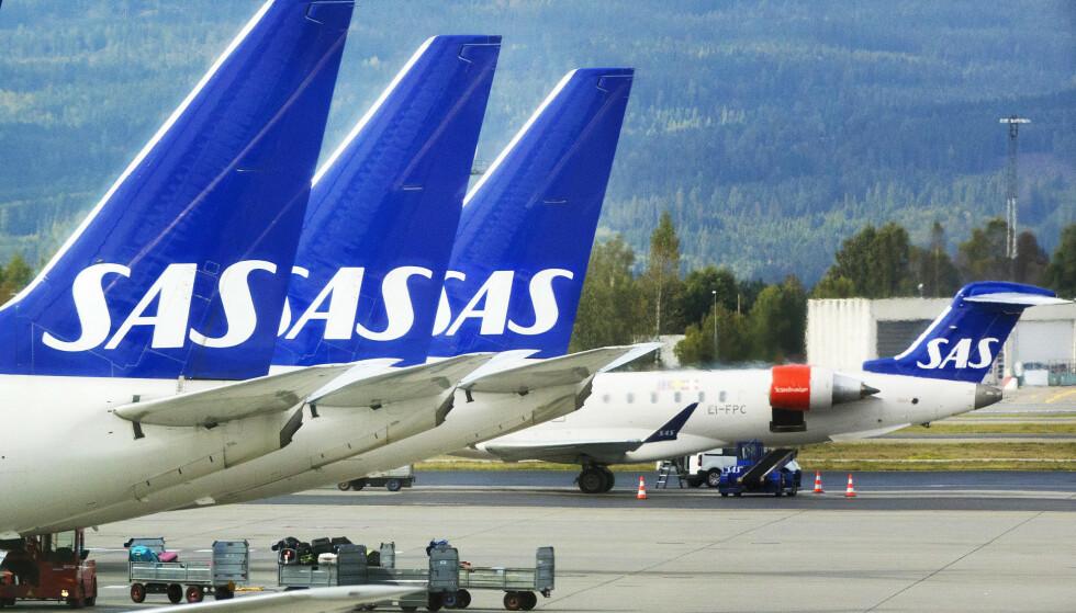 KAN BLI STÅENDE: Dersom ikke SAS og pilotene kommer i mål med lønnsforhandlingene, kan tre av fire SAS-fly bli stående på fredag. Foto: Gorm Kallestad/NTB Scanpix