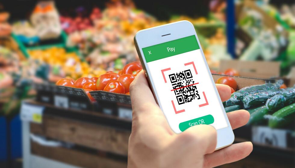 BETALE MED VIPPS: Før jul skal du kunne betale med Vipps i butikk - hvis butikken har en løsning for scanning av QR-kode. Illustrasjonsfoto: NTB Scanpix