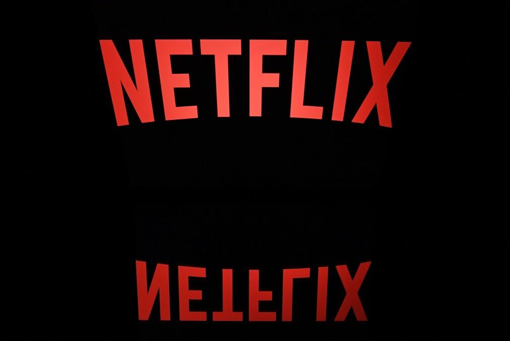 BLIR DYRERE: Netflix øker prisen på et premium-abonnement med 20 kroner. Foto: Lionel Bonaventure/AFP/NTB scanpix