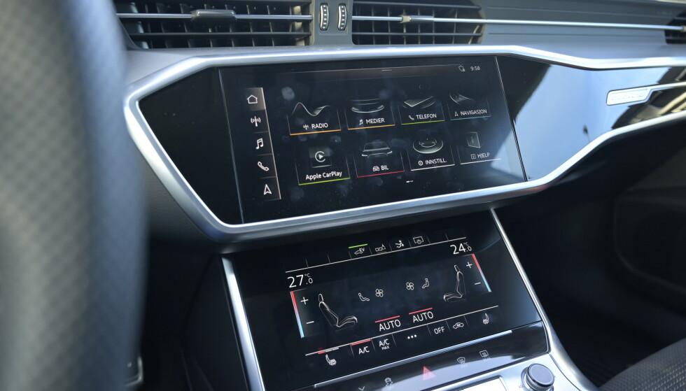 DET MESTE PÅ SKJERM: Store hovedmenyer og kortkommandoer for de viktigste funkjonene, gjør det enkelt å navigere i Audis digitale univers. Men trafikksikkert er det ikke. Foto: Rune M. Nesheim