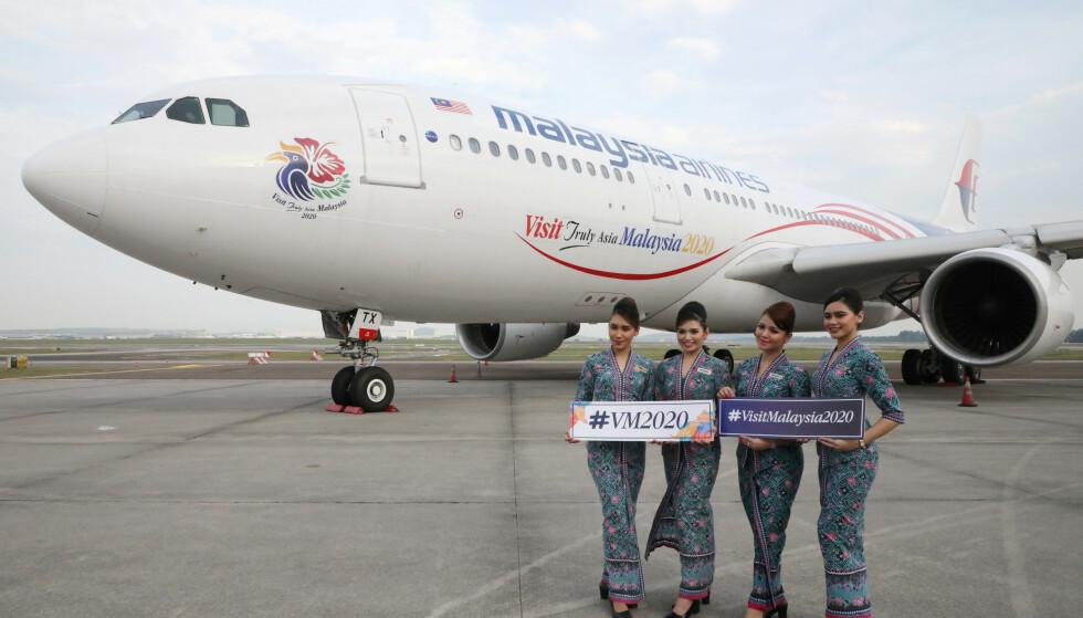 VEIDE FOR MYE - FIKK SPARKEN: En flyvertinne i Malaysia Airlines fikk sparken fordi hun veide 700 gram for mye. Nå har retten bestemt at oppsigelsen var helt innafor. Foto: NTB scanpix