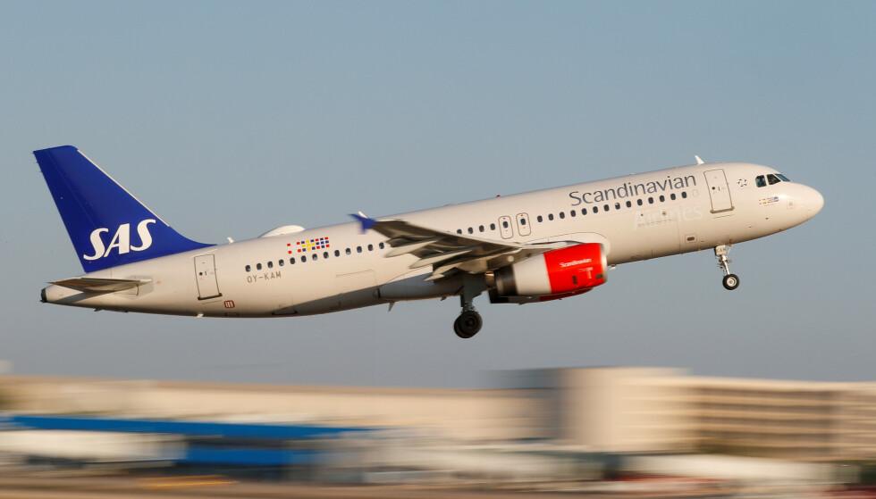 KUTTER: SAS vil redusere kapasiteten, altså kutte i flygningene, i Skandinavia og Europa. Hvordan dette vil ramme norske innenriksruter, er for tidlig å si, ifølge SAS Norge. Men de sier det helt sikkert vil ramme norske reisende som skal ut i Europa og verden. Foto: NTB scanpix