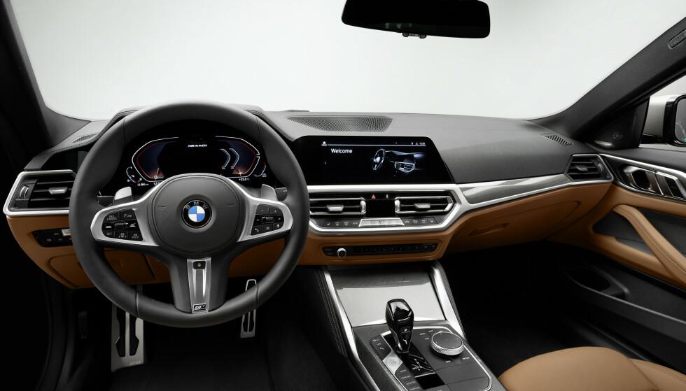 SOM VANLIG: Interiøret er stort sett helt likt det vi ser i øvrig modellprogram. Foto: BMW