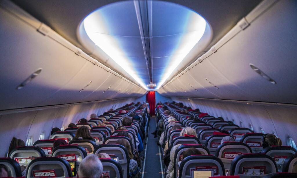 MIDTSETE: Helsemyndighetene sier de vil revurdere midtsetekravet på fly. Foto: Ole Berg-Rusten / NTB scanpix