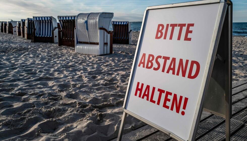 <strong>TYSKE REGLER:</strong> Skal du til Tyskland i sommer, er det greit å vite hvilke regler som gjelder for innreise, karantene og andre regler for opphold og aktiviteter. Du oppfordres til å holde minst 1,5 meter avstand til andre til enhver tid, og det er maskeplikt på offentlig transport - og du anbefales å bruke maske på alle offentlige steder. Foto: NTB scanpix