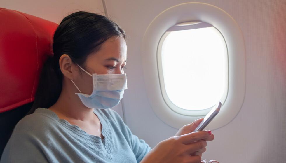 SMITTEFARE: Det kan være lurt å velge vindussete for å begrense faren for smitte på fly. Foto: Shutterstock/NTB Scanpix