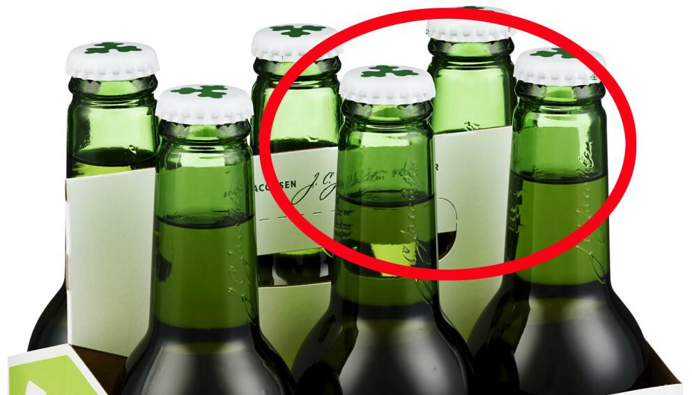 SJEKK KORKEN! Ringnes tilbakekaller alkoholfri Carlsberg etter at det er oppdaget at sekspakninger inneholder flasker med alkoholholdig øl. Selve flaskene er imidlertid korrekt merket, og du kan sjekke etiketten på selve flaska og i tillegg korken - som er hvit på alkoholfritt og grønn på alkoholholdig. Foto: Carlsberg