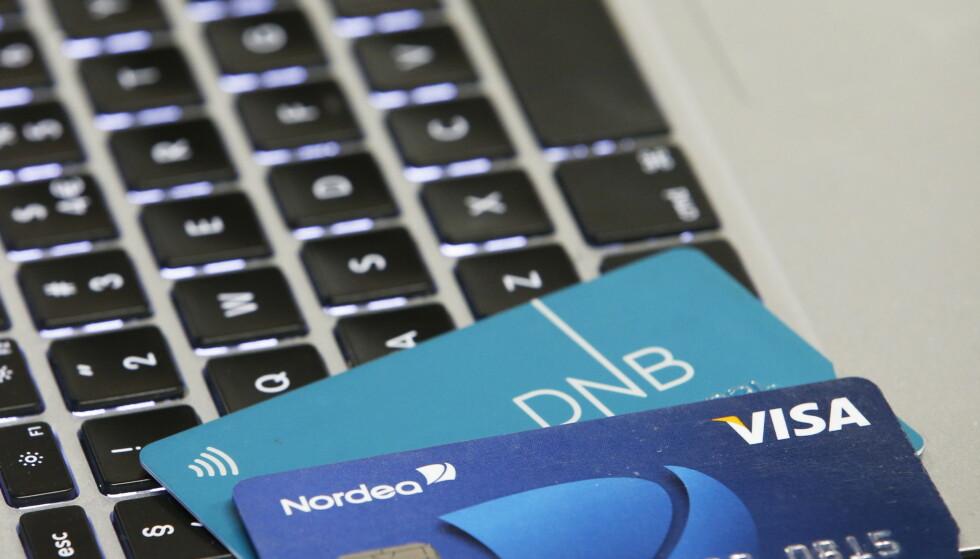 SVINDEL: Norges to strste banker Nordea og DnB bekrefter at de har kunder som er rammet av den omfattende nettsvindelen med kort. Svindelen øker i omfang. Foto: Erik Johansen / NTB