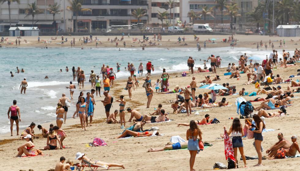 JULEFERIE: Drømmer du om å feire julen 2021 på Gran Canaria, for eksempel? Da må du ta ut flere feriedager enn normalt. Foto: NTB/REUTERS/Borja Suarez