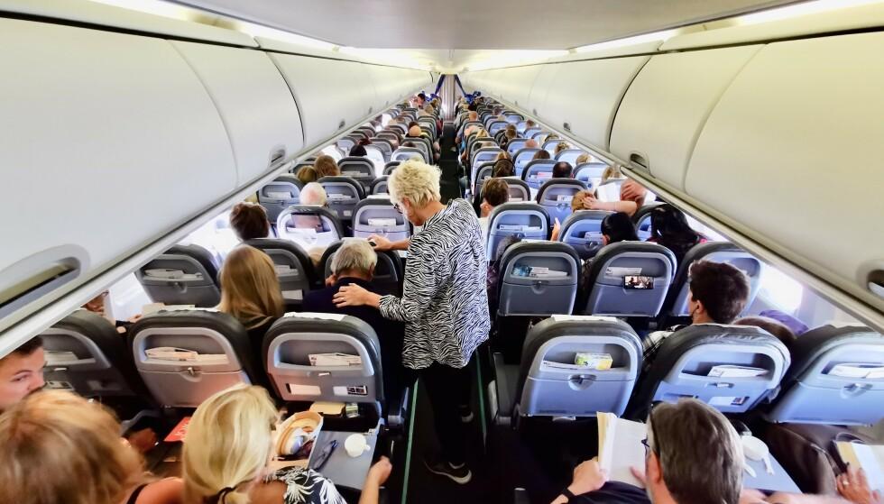 Bevegelse: Det er smart å røre seg på lange flyreiser, men sett deg inn i flyselskapets smittevernregler først. Foto: Odd Roar Lange/The Travel Inspector